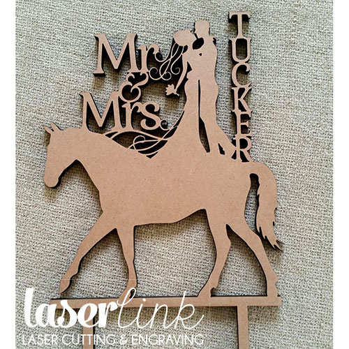 bride and groom horse cake toppers