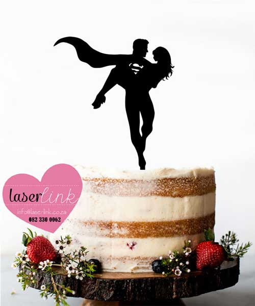 superman holding lady cake topper