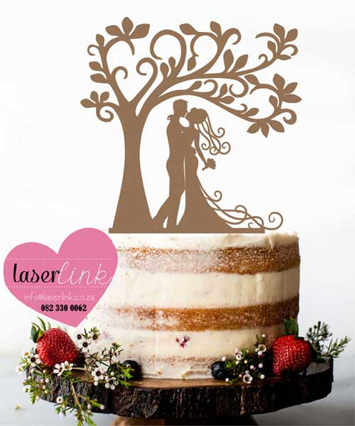 bride and groom with tree cake topper