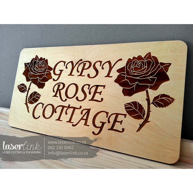 wooden cottage sign board